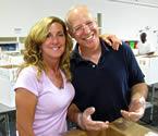 Mariah DeLeon and Alibris employee Steve Pollack volunteer at a local food bank.